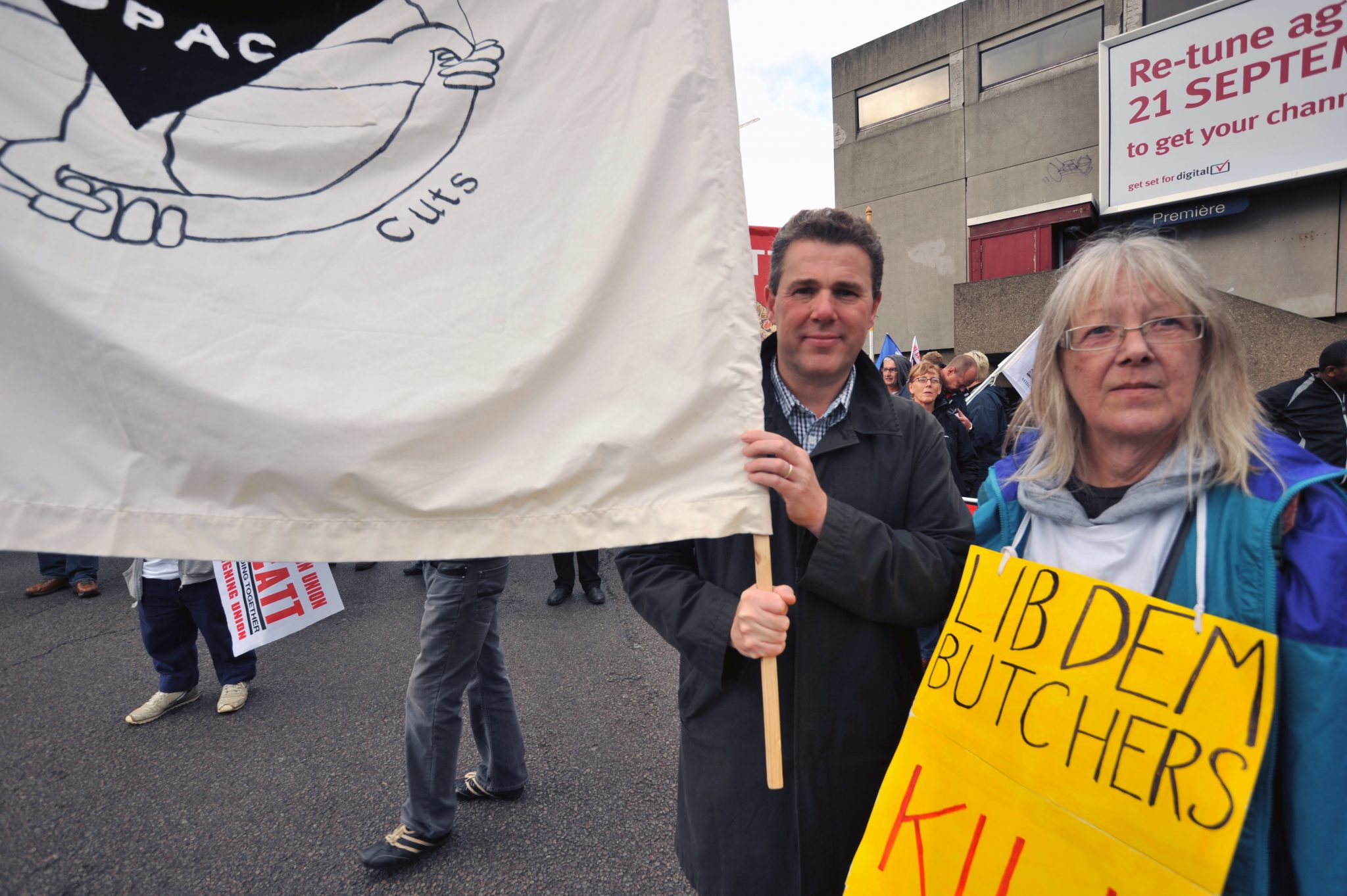 Mark Serwotka carrying DPAC banner
