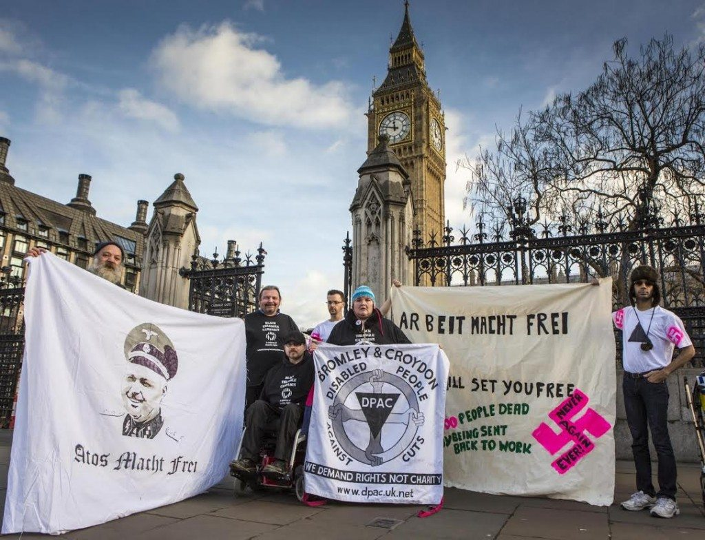 Disabled activists today stood outside 10 Downing Street and the Houses of Parliament to remember the disabled victims of the Nazi Holocaust on the 70th anniversary of the liberation of Auschwitz. The protest-vigil also stood to highlight current injustices such as the approximate 1,300 people who died with 6 weeks of their work capability assessment.