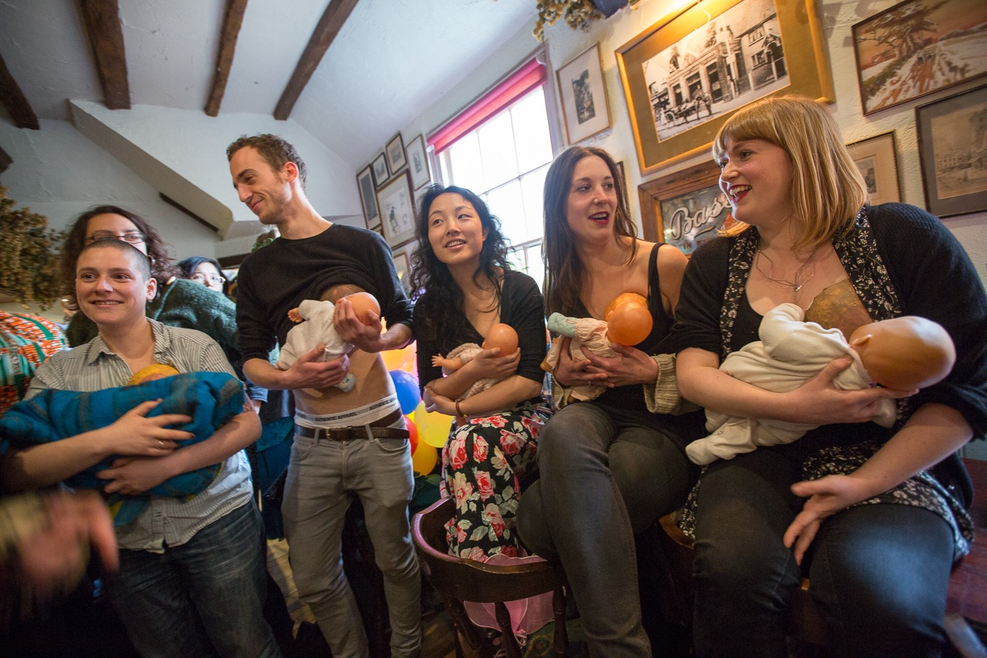 fake breast feeding in public, but not in a corner as Farage suggests