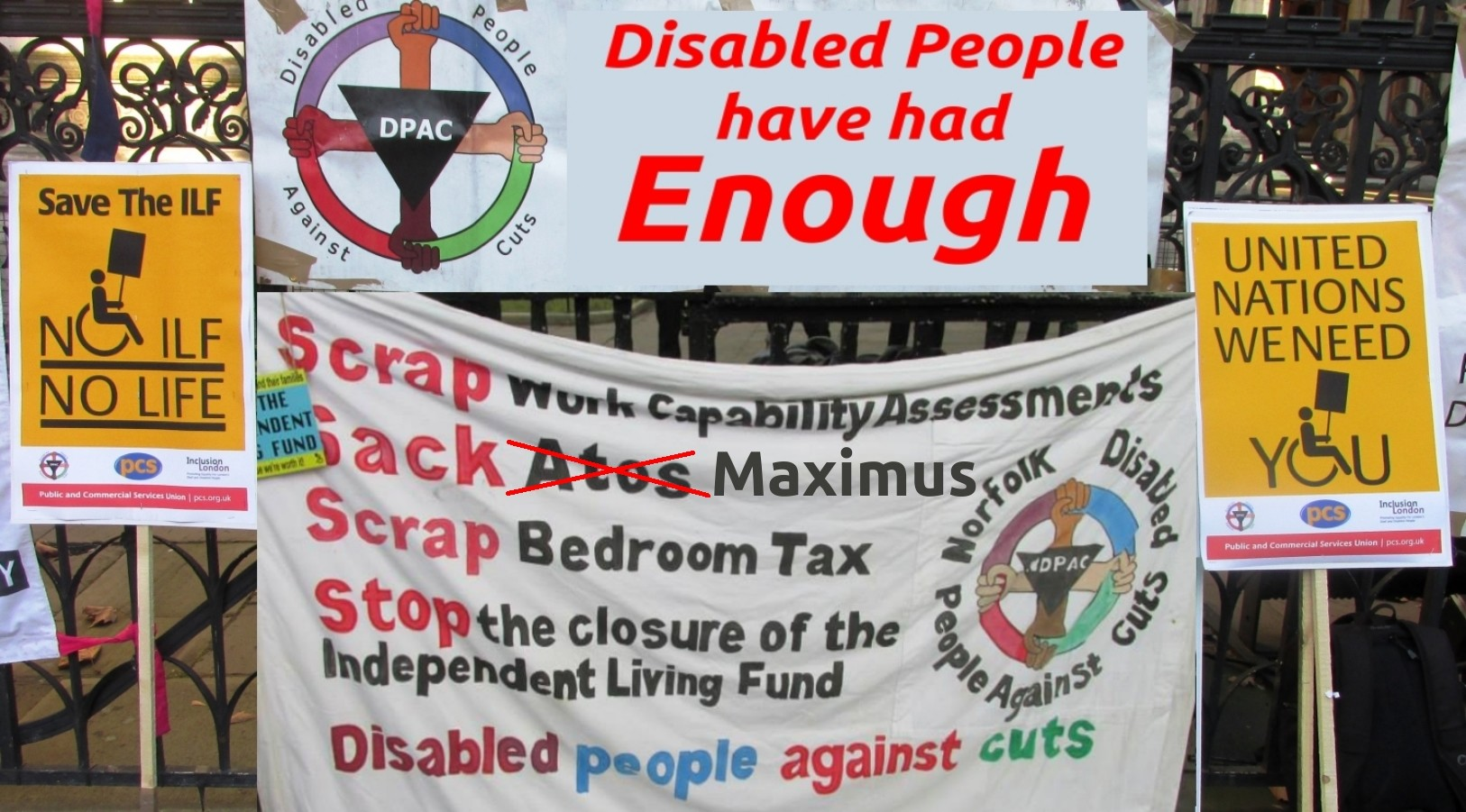 "Picture with campaiging banners, with the text ""Disabled People have had enough"""