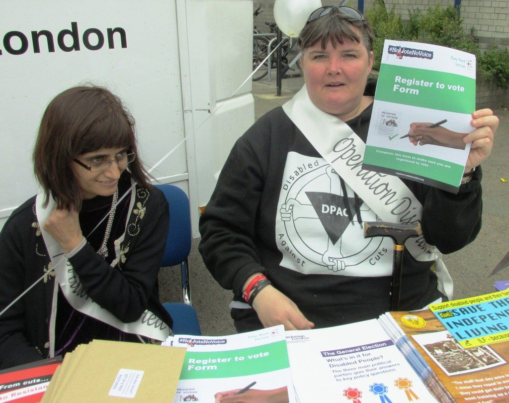 Sabina lahur and Paula Peters (holding a easy read version of the voter registration form at the operation disabled vote information table Brixton launch)