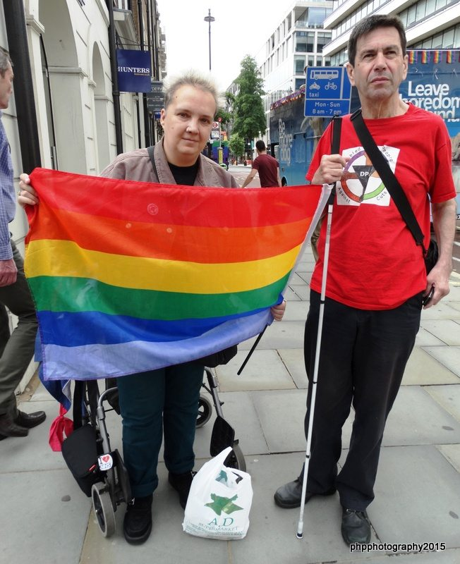 Louise (Bromley DPAC) with Roger and Pride flag