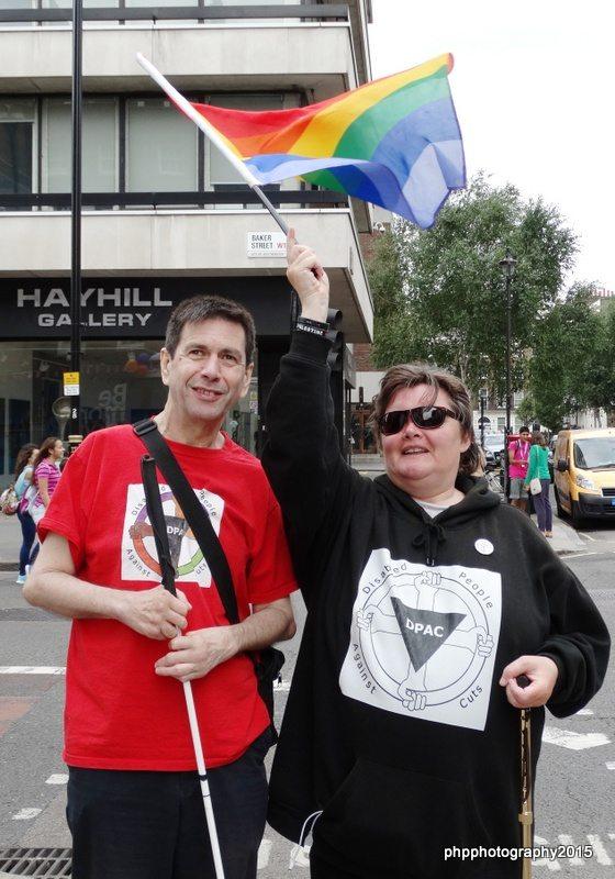 Roger and Paula, waving Pride flag