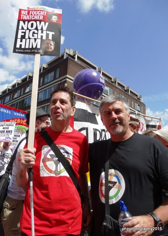 Roger from DPAC with Jim (wearing his DPAC t shirt) and placards on Pride march