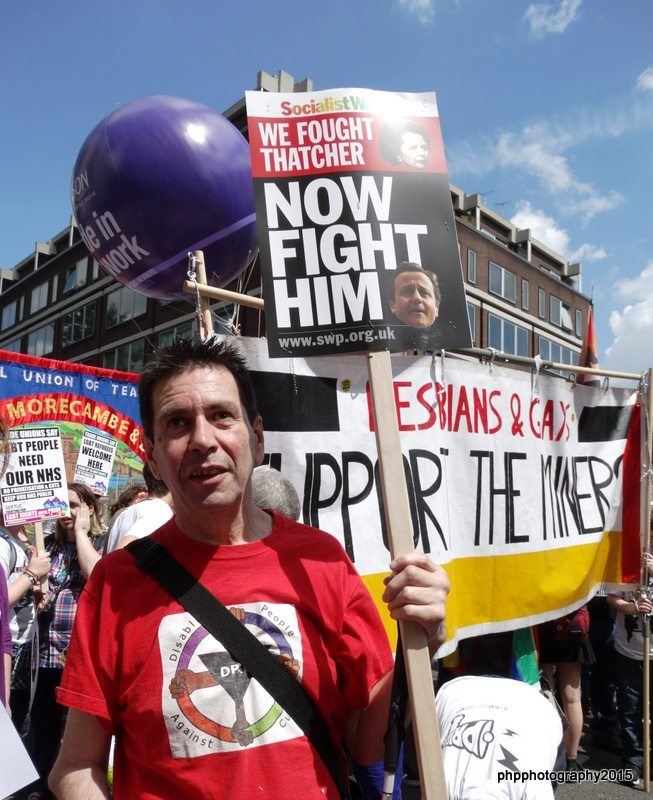 Roger with placard on Pride march