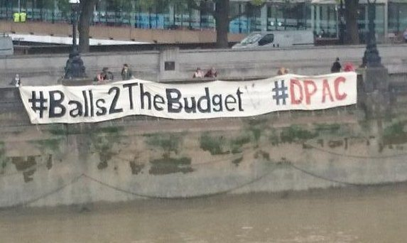 "Massive Banner Dropped across the Thames opposite Parliament - reads ""'Balls2TheBudget #DPAC"""
