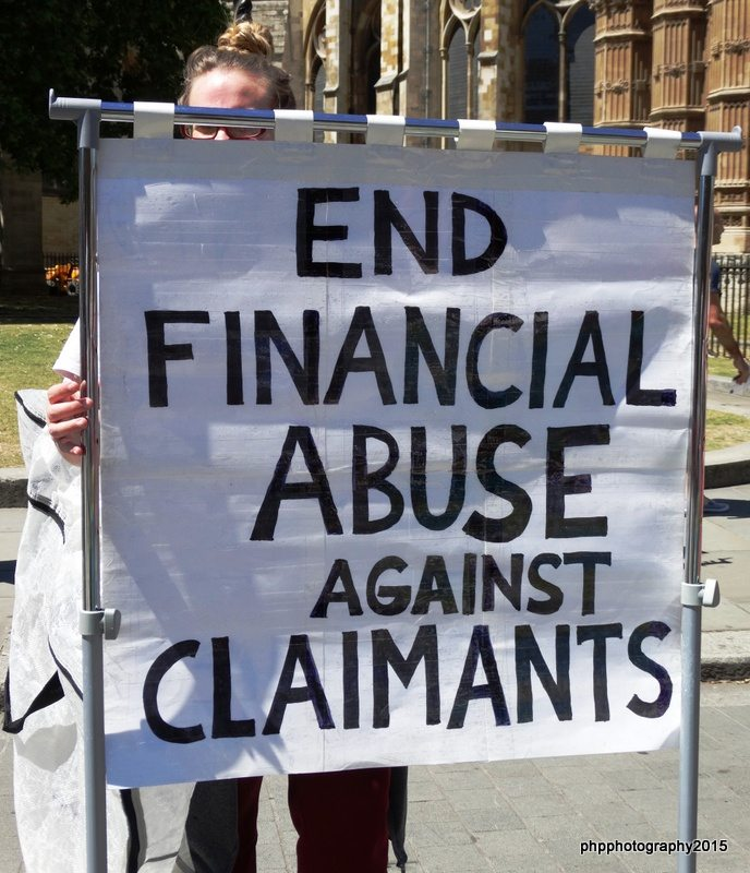 Kilburn Unemployed workers group with end financial abuse against claimants placard