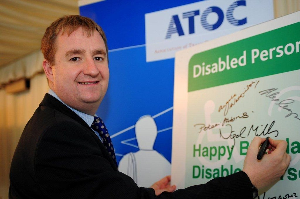 "Grinning inanely while posing for a picture of himself ""supporting disabled people"". Nigel Mills MP - who then voted for the ESA Cut"
