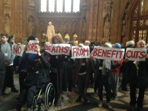 "Protestors holding placards saying ""No More Deaths from Benefit Cuts"" - Photo Credit: Paula Peters"