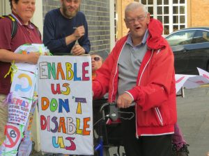 Brighton DPAC at Crown House PIP Assessment Centre. Poster reads Enable Us Don't Disable Us