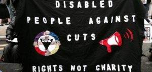 DPAC banner which says Disabled People Against Cuts: Rights not Charity