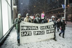 Our Allies in Canada, OCAP, marching through a blizzard fighting to save the lives of homeless people in Toronto