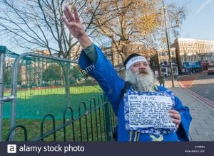 Picture with caption: Roy Bard of MHRN makes a Nazi salute to show his opinion of forced back to work treatment for mental health sufferers to be given in the new Southwark 'hub' at Thames Reach Employment Academy.