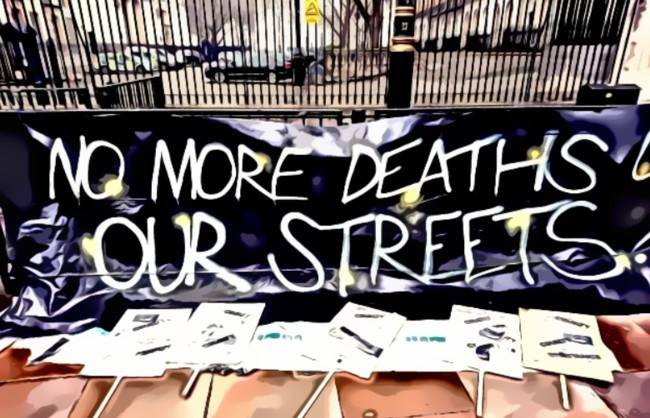Banner reading: No More Deaths on Our Streets
