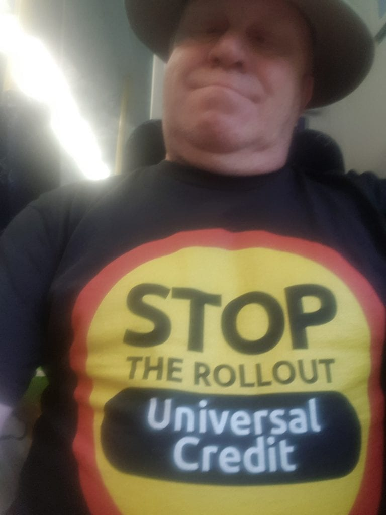 Man wearing a Stop the Universal Credit Rollout tshirt